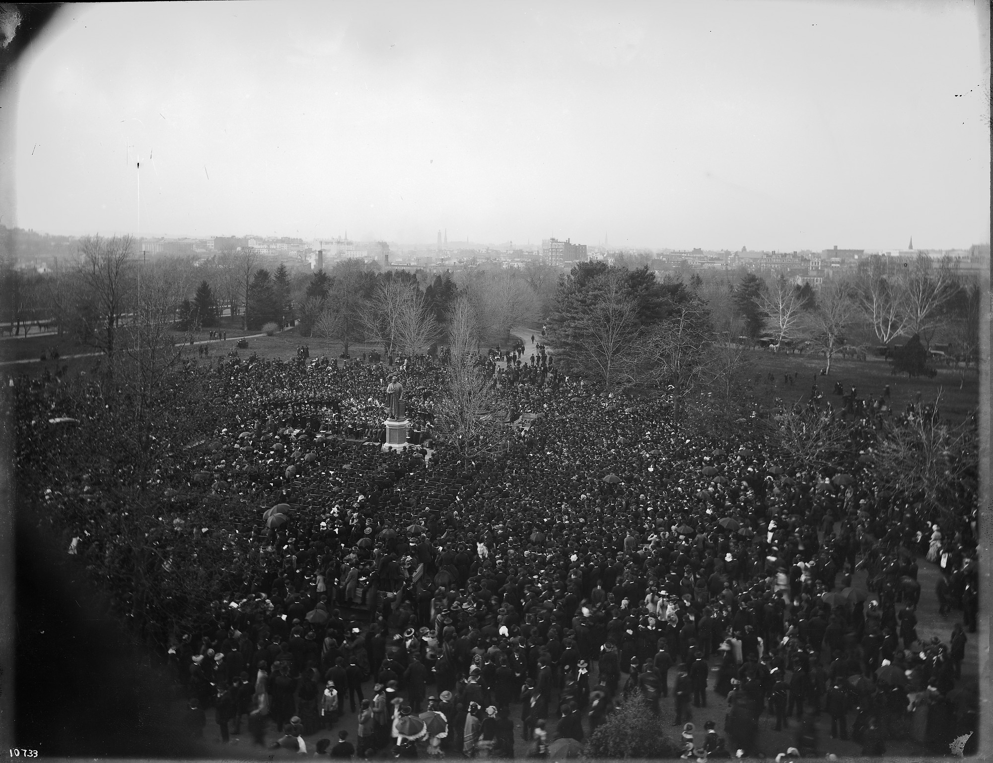This photo, taken through a window in the Castle, captures the crowds that gathered for the Joseph Henry statue dedication in 1883. Courtesy of the Smithsonian Institution Archives.