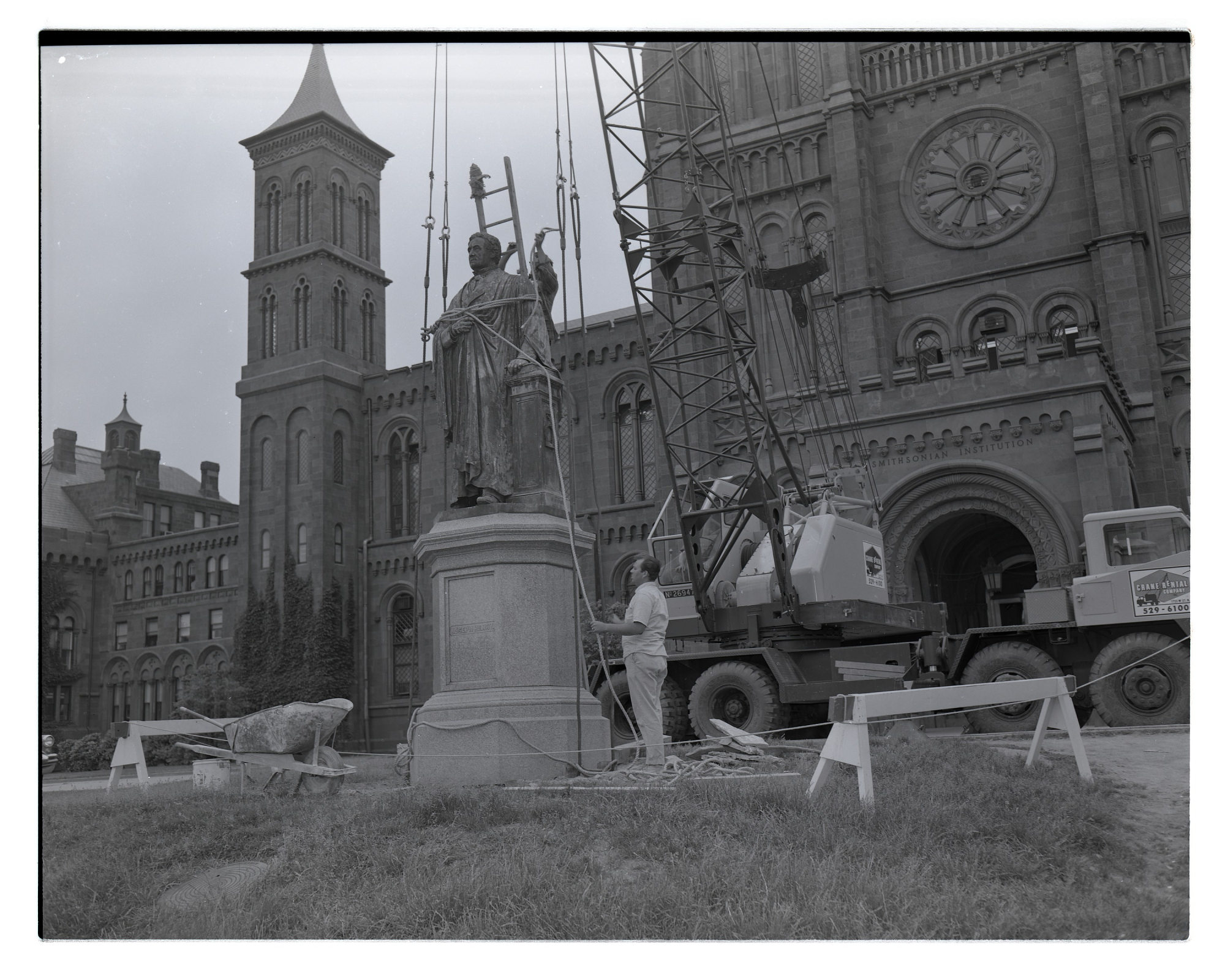 In 1965, the Joseph Henry statue was turned outward, so that he symbolically faced the Smithsonian museums that followed in his footsteps. Courtesy of the Smithsonian Institution Archives.