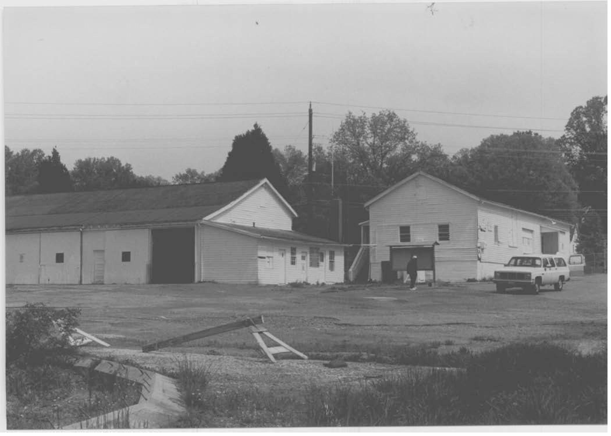 """On the property, both buildings of Smithville Colored School can be seen. They make a unique """"L"""" shape. Also, shows how simple the construction of the two buildings was."""