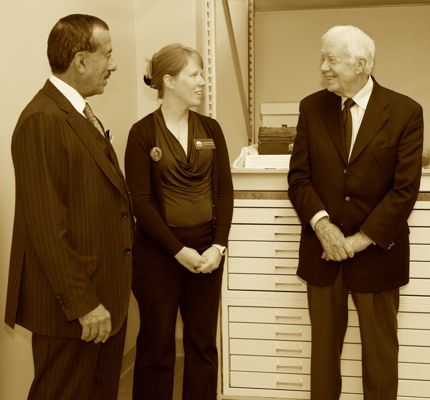This picture shows Dr. Khalaf Al Habtoor (left), Professor Jenny Barker-Devine (middle), and former president Jimmy Carter on the day the archives where dedicated. Taken from within the archives.