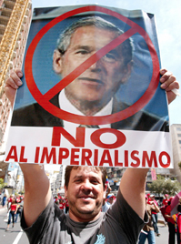 "A protestor holds a sign reading ""No to imperialism."" Evo Morales's insulting of the United States regimen was a major factor tat led to his first presidential term."