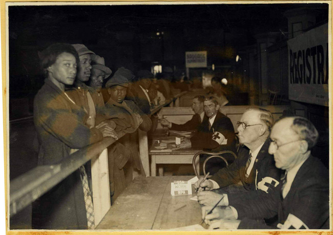 Photo depicting refugees from the 1937 flood registering with members of the WPA (Works Progress Administration) at Ellis before being transferred to Central High School.