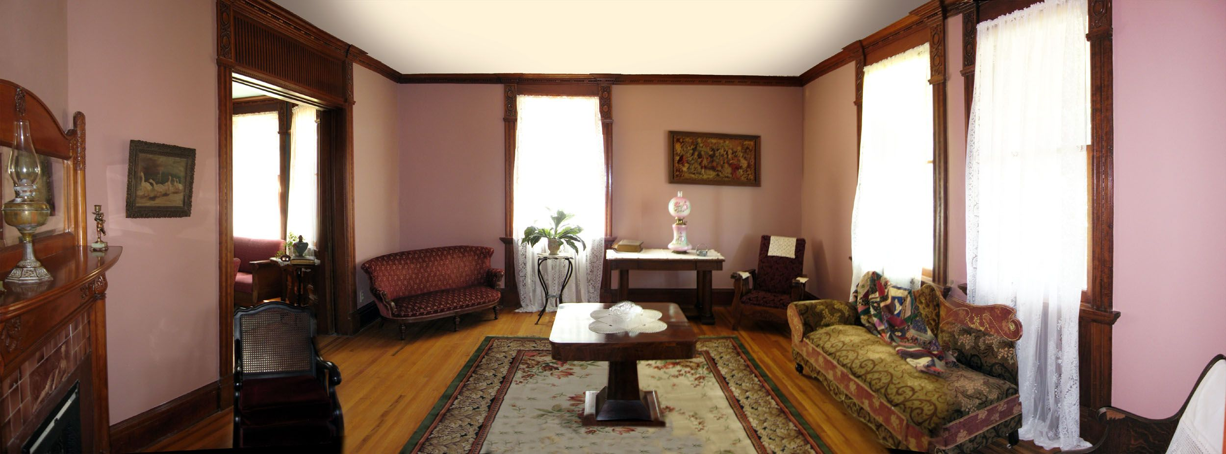 This is the living room and the parlor can be seen with the double pocket door off to the left.