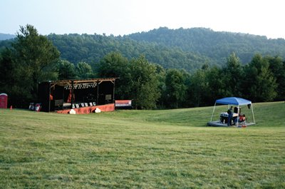 The stage in the large field used for performers to share their talent for travelers, locals, and visitors to the area.