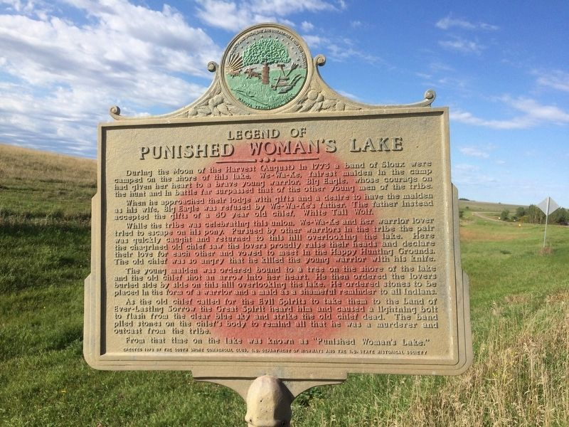 "Picture of the highway marker, erected in 1973, that tales the story behind the name of ""Punished Woman's Lake""."