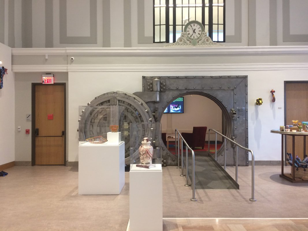 The former bank's original vault and clock are now part of SAM's entrance lobby.