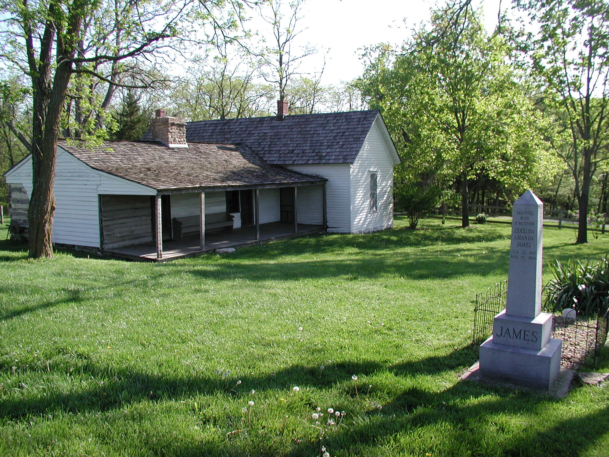 The James Farm, with a replica of Jesse's headstone at the site of his former grave