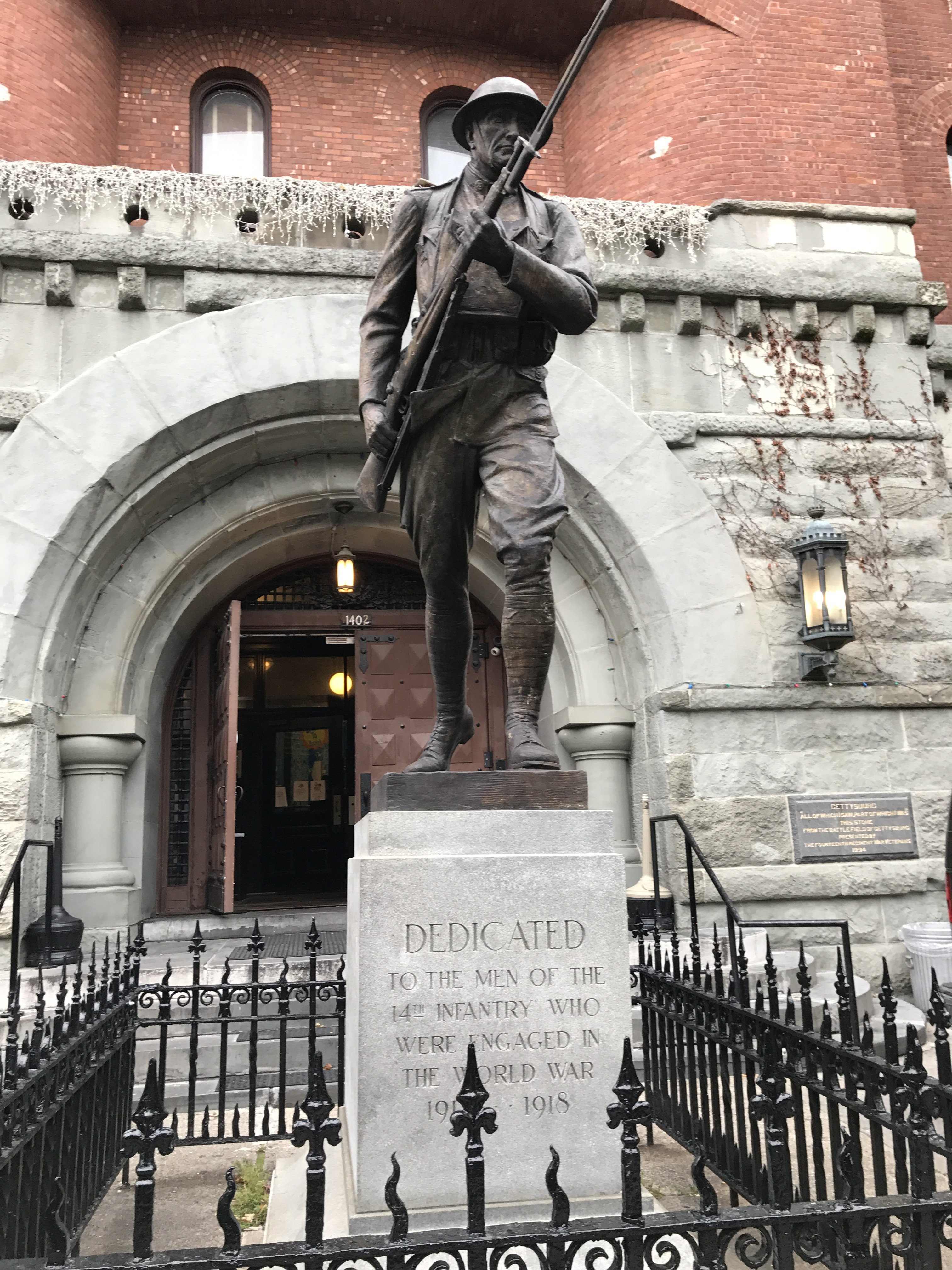 Front of Statue, outside of Park Slope Armory, YMCA. Bronze depiction a World War I Infantry soldier or Doughboy- on 8th Avenue side of building, intersection between 8th Avenue and 15th StreetPhotographer: