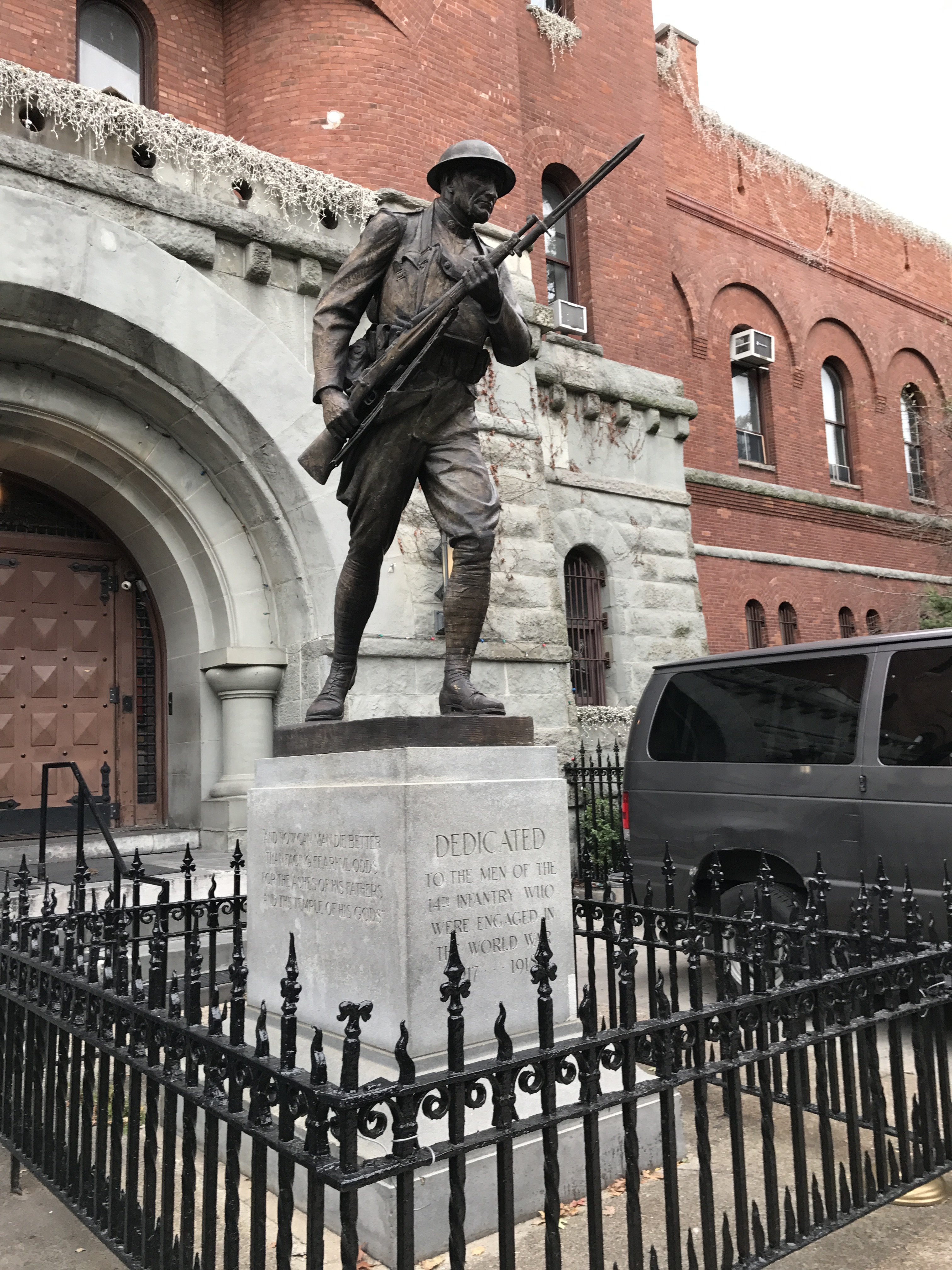 Left side of statue- on 8th Avenue side of building