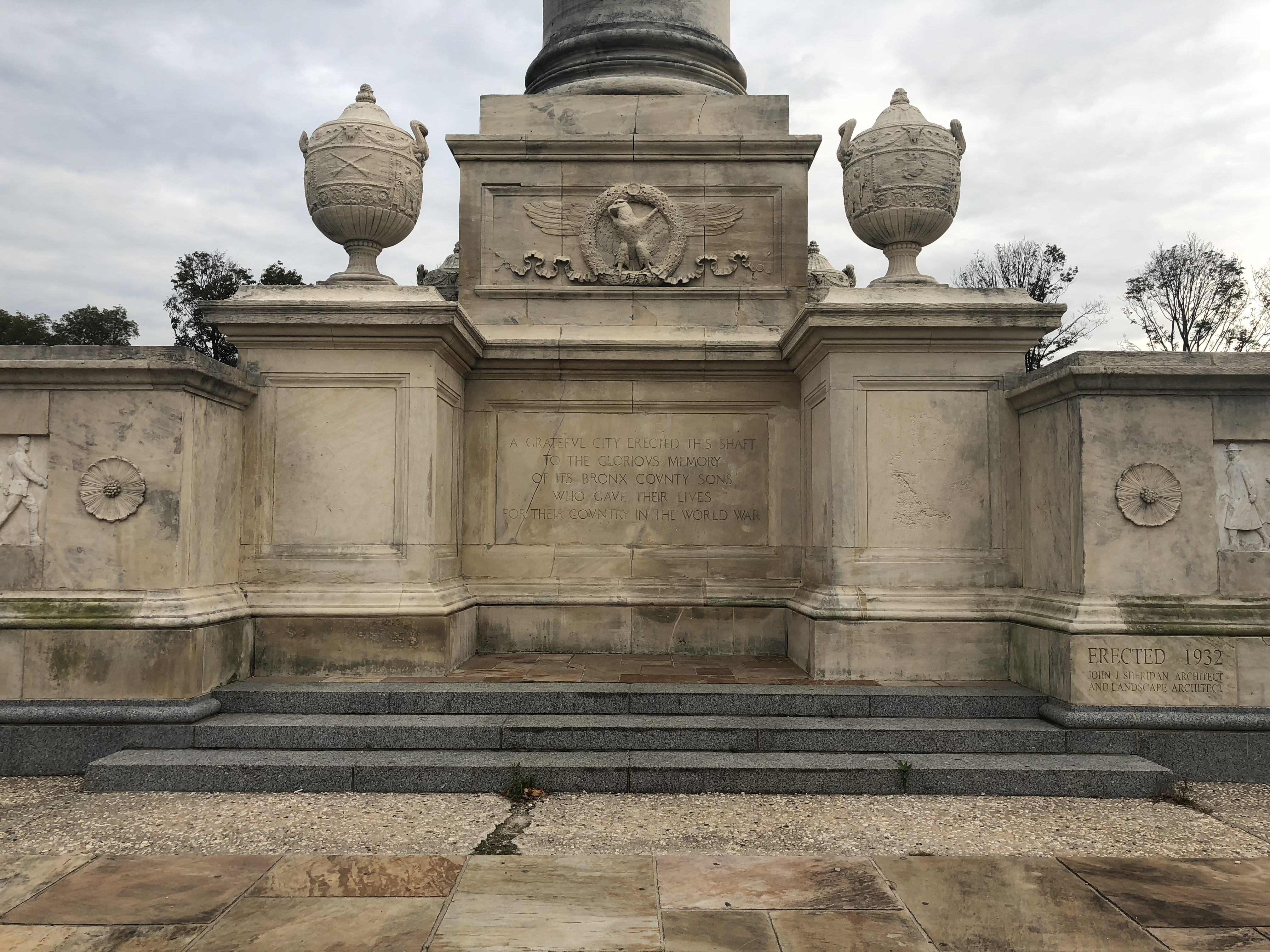 "The base of the monument reads: ""A GRATEFUL CITY ERECTED THIS SHAFT TO THE GLORIOUS MEMORY OF ITS BRONX COUNTY SONS WHO GAVE THEIR LIVES FOR THEIR COUNTRY IN THE WORLD WAR"""