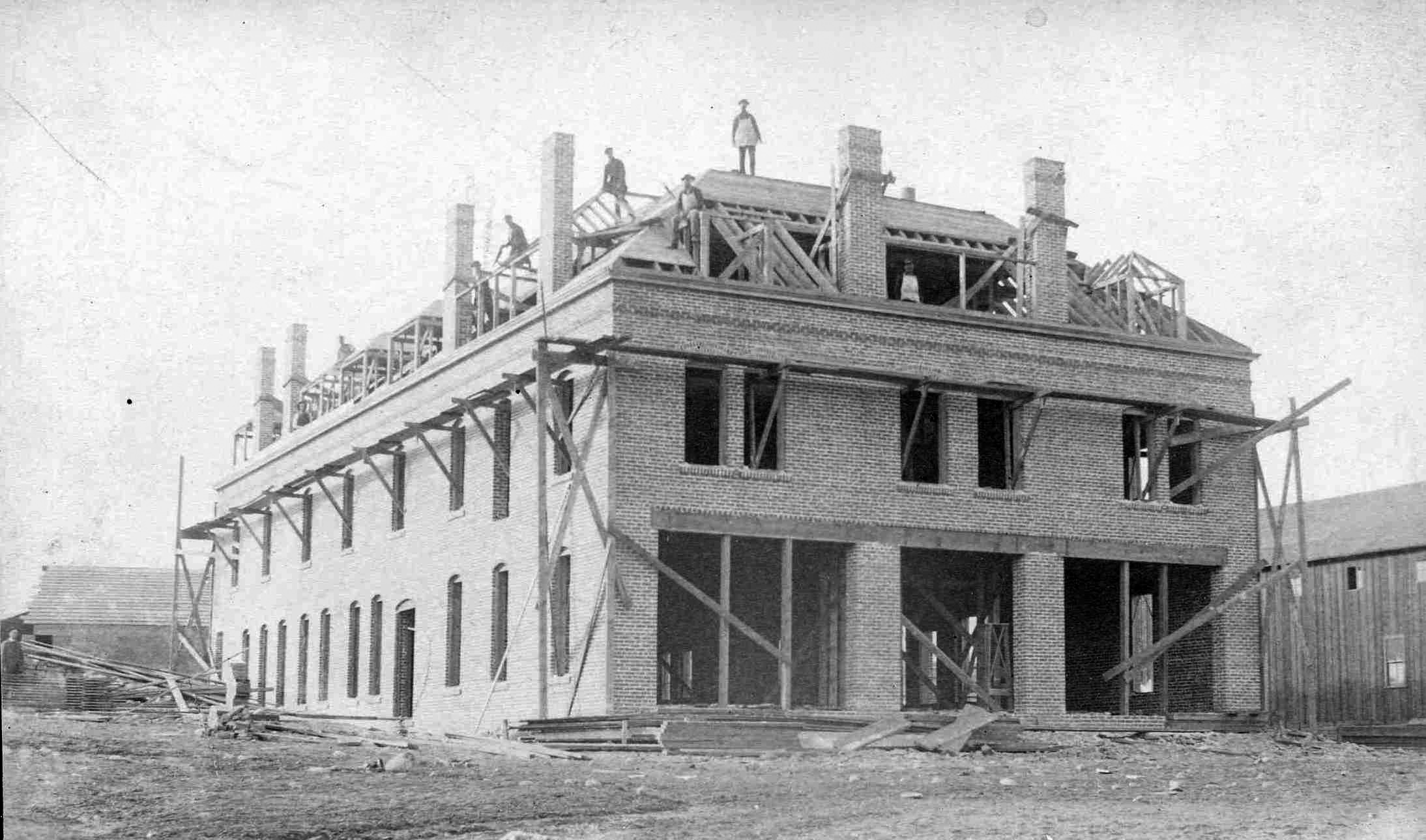 An 1893 black and white photo; construction of the brick Clark Hotel that was to become the first Courthouse for Chelan County