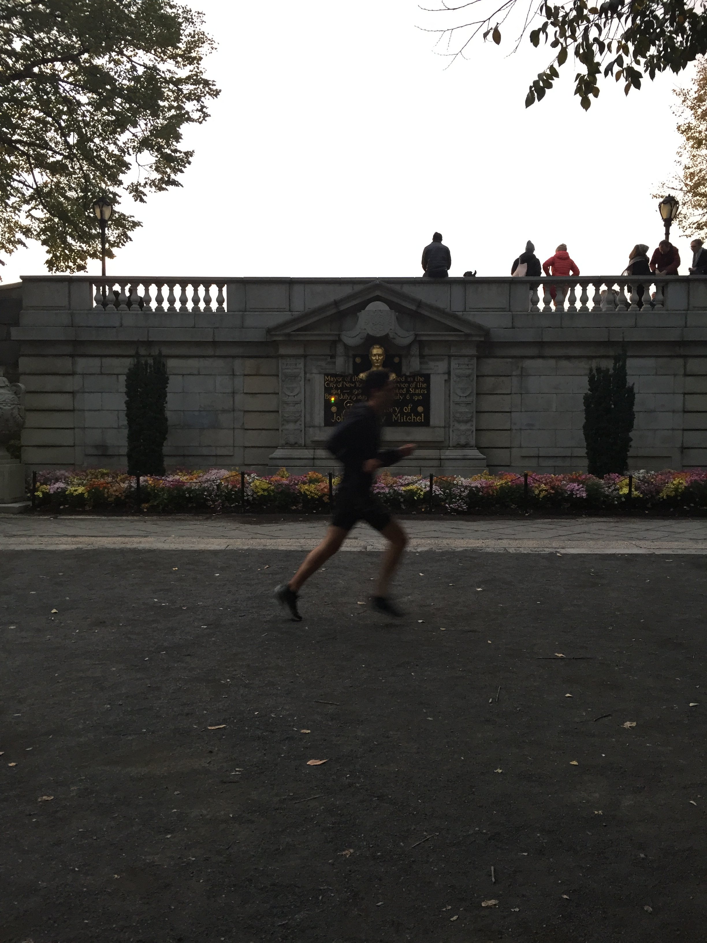 The monument compared to the scale of a human runner in the park.