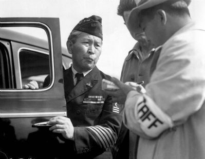 An unidentified navy veteran of Japanese ancestry reports to the assembly center for processing.