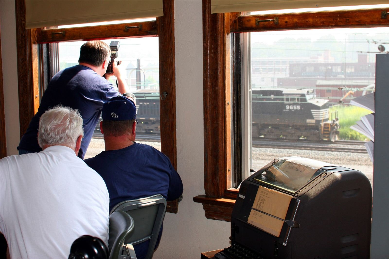 A few railroad aficionados train spotting from the second floor of the Harris Switch Tower.