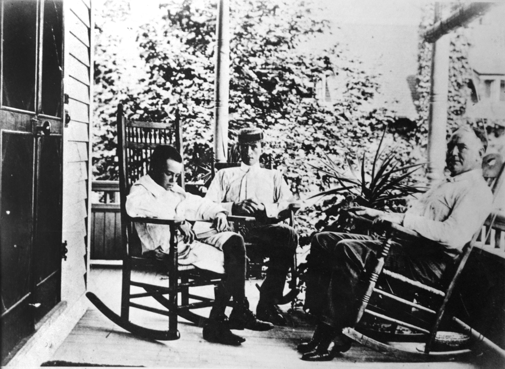 The O'Neill men, James, Jamie and a young Eugene, on the porch of the Monte Cristo Cottage.