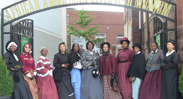 Reenactors dressed in reproductions of period clothing