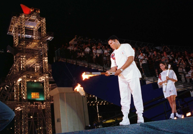 Muhammad Ali lighting the Olympic Flame at the 1996 Olympic Games.