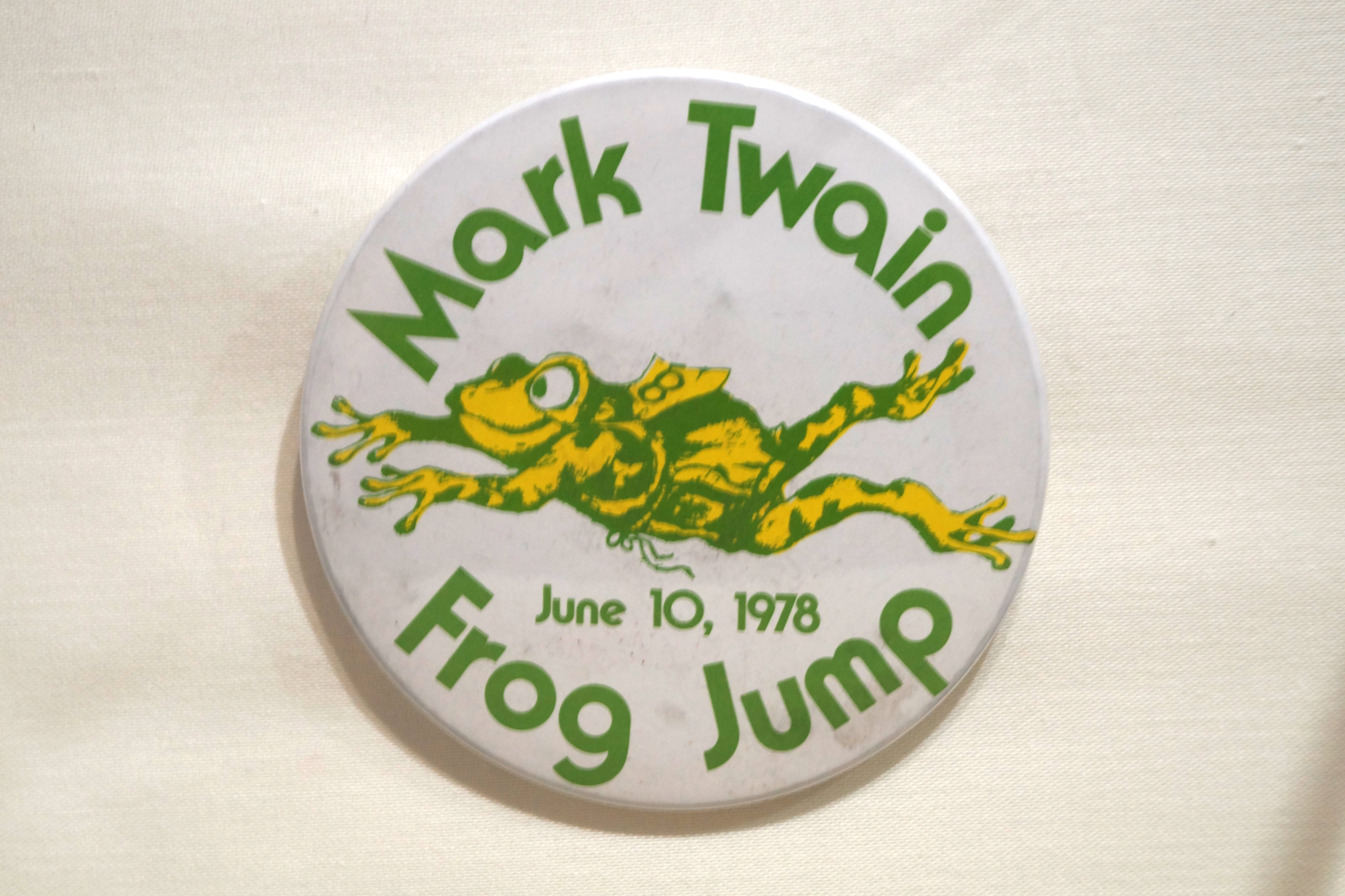 """The first press reference to a jumping frog contest in Hartford - commemorating """"The Celebrate Jumping Frog of Calaveras County,"""" Clemens's breakthrough work of 1865 - is from 1944 when a tourney was held in Colt Park.  Ten teams represented city boys' clubs and the Hartford Junior Police Legion of Honor.  In the 1950s the Mark Twain Memorial Commission and the Hartford Children's Museum organized an annual contest which was wildly popular.  The winner of the last run race probably wore a button like the one displayed.  In 1979 sentiment against the use of animals in sport led to the discontinuation of the event."""