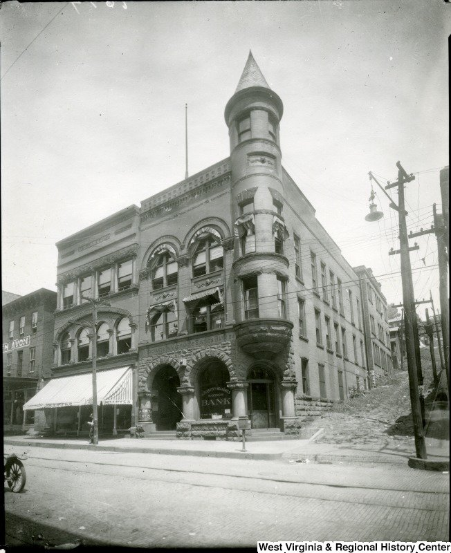 The Merchants and Mechanics Savings Bank in 1924. Note the presence of the witch's cap, which was removed due to safety concerns. Photograph from West Virginia and Regional History Center at WVU Libraries