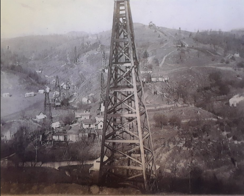 An oil derrick overlooking Stringtown, WV circa the 1920s. (Photo credit: photographer unknown/copy from the Dye family)