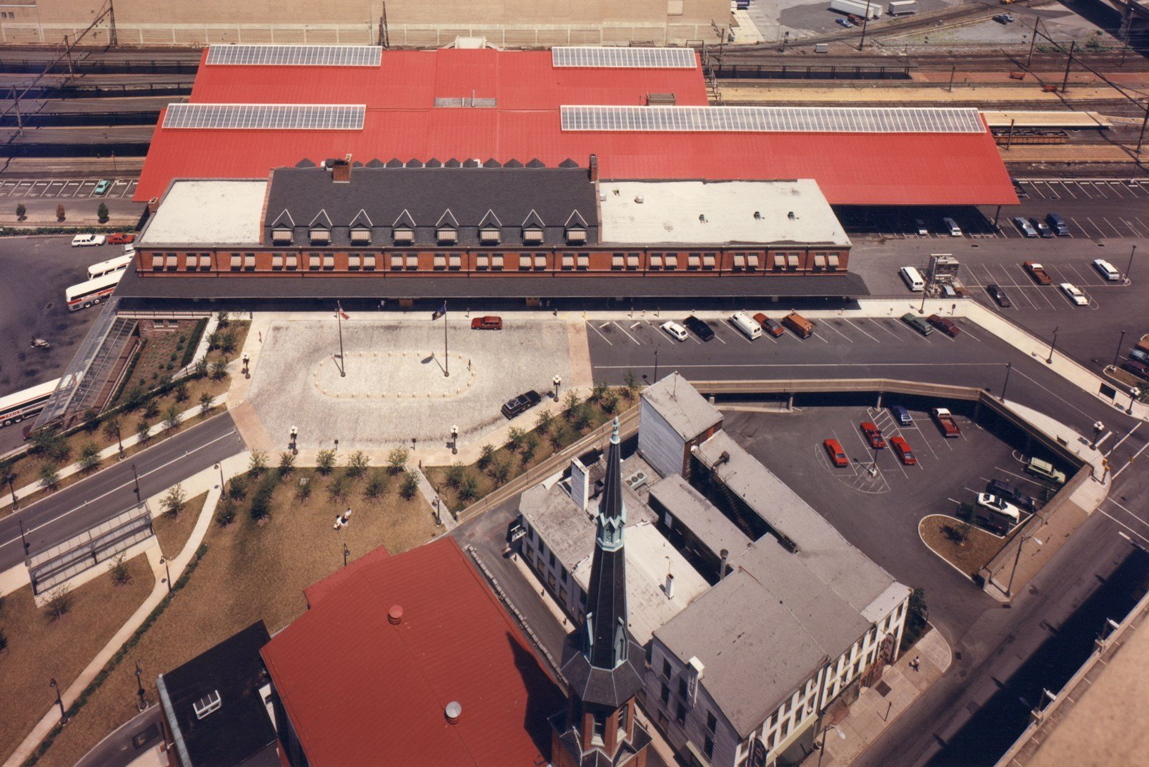 An aerial shot of the HTC with the massive, red-roofed train sheds located behind the station.