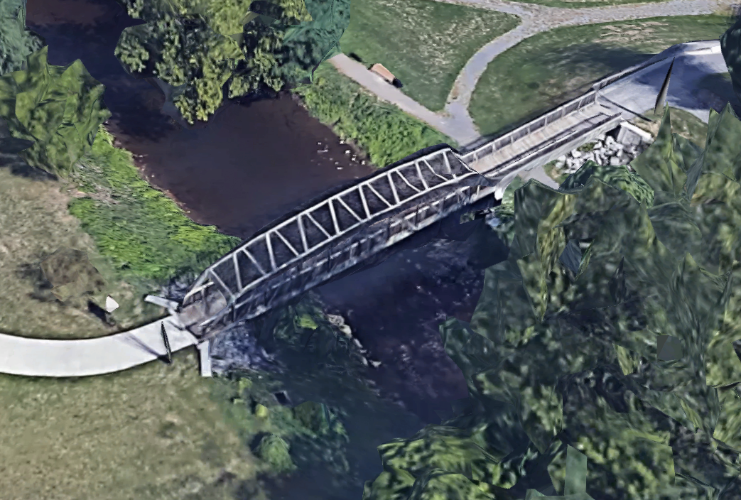 The bridge leading to Canal Basin Park, which used to reside over a dam that fed water into the basin