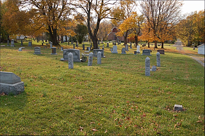 Multiple resting places of African American graves at Newtown Cemetery.