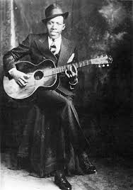 This photo is possibly the most famous picture of Robert Johnson. Not very many pictures of him exist and this is one of the few.