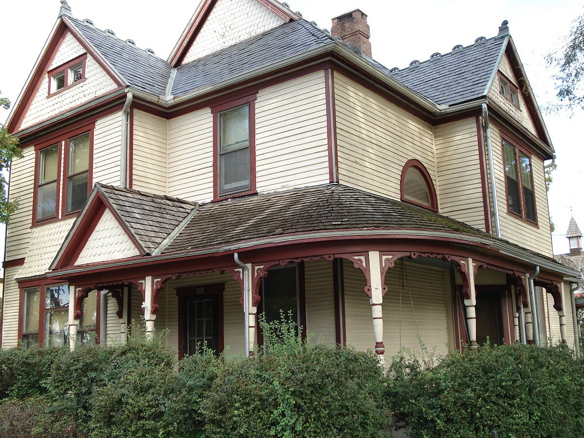This asymmetrical house is built in the Queen Anne style.