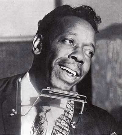 Slim Harpo with harmonica
