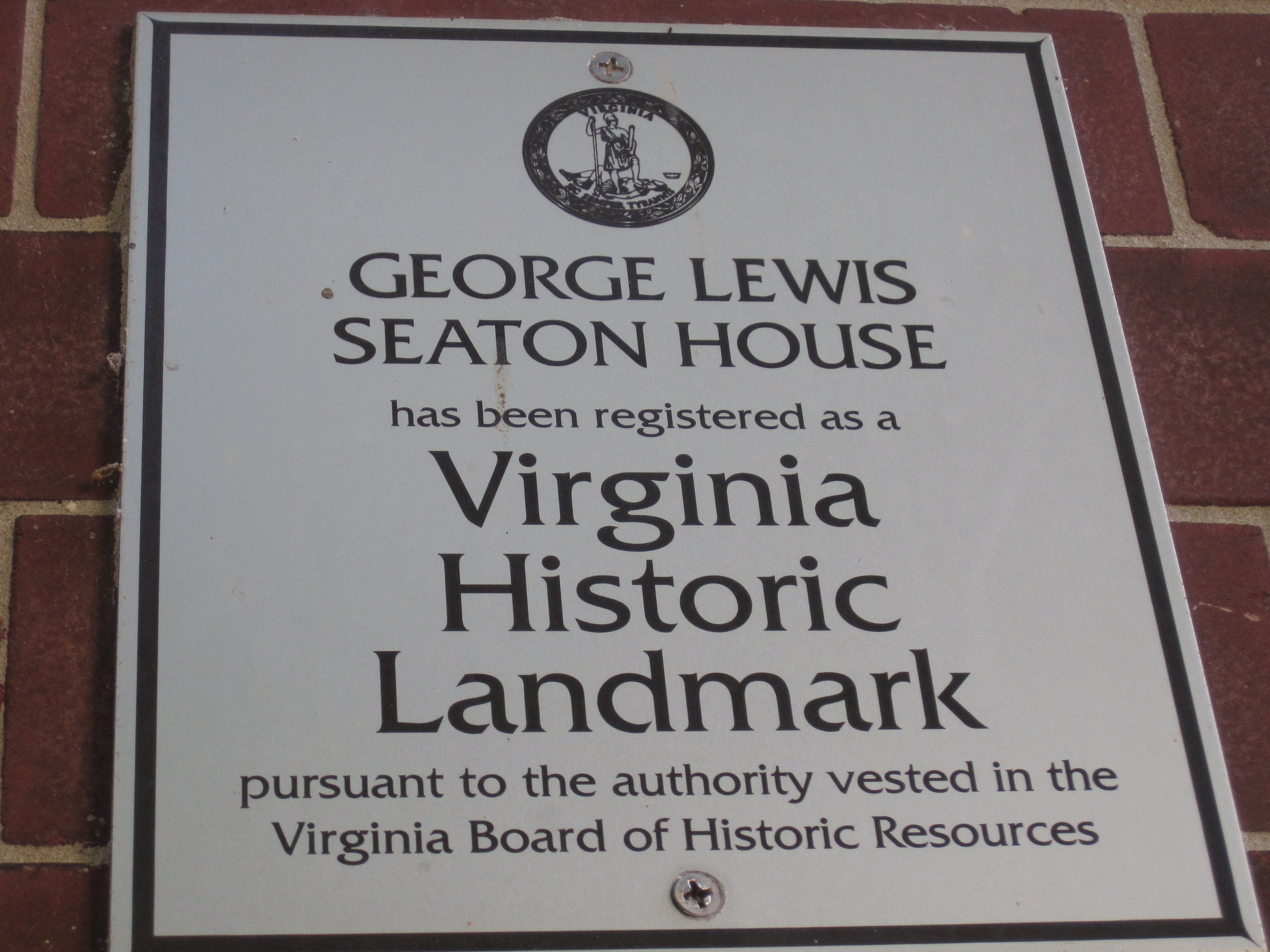 Plaque found on the property, commemorating the late George L. Seaton.