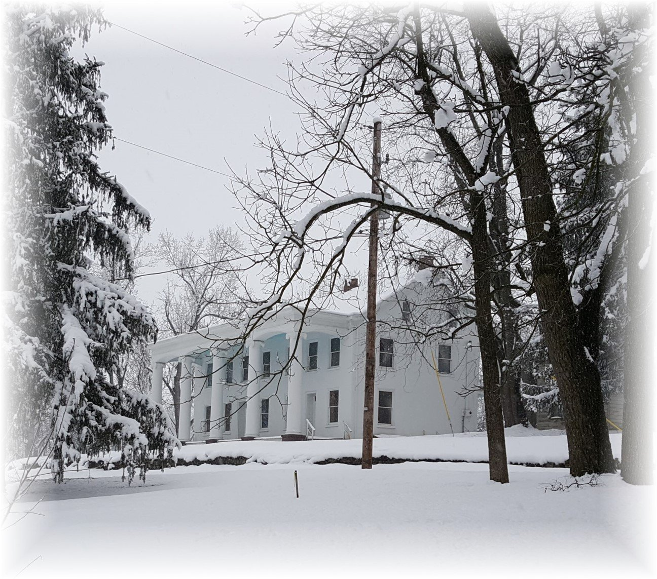 The plantation's mansion and grounds under a blanket of snow.