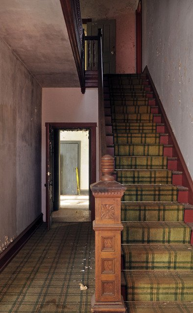 An interior staircase within the mansion.