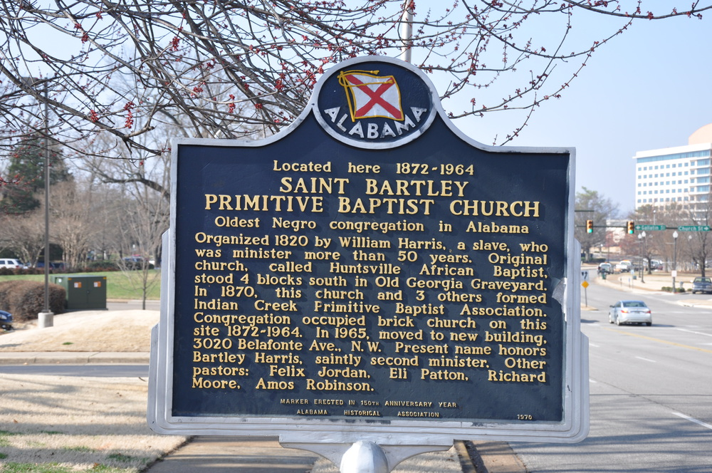 One side of the marker which states the overview of the St. Bartley Church located on Williams Avenue.
