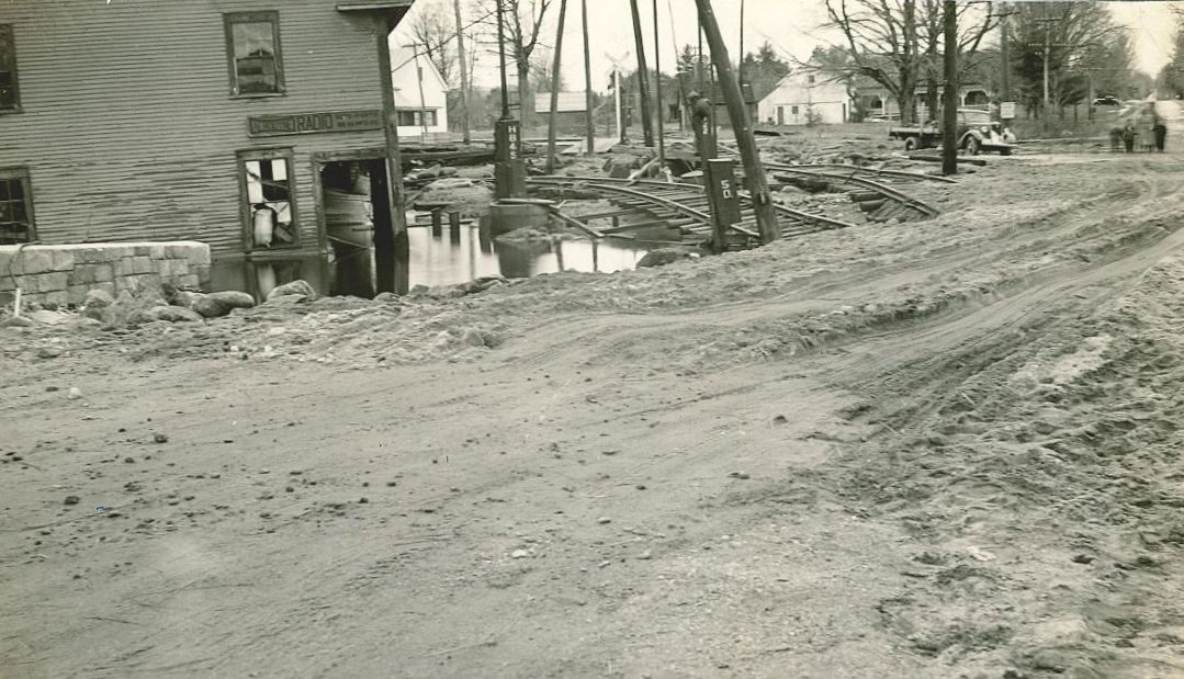 One of the businesses which suffered extensive damage from the flood of 1936 was the Nelson Grain Mill, which was sheared in half. Also visible in the photos is the damage to the railroad tracks.
