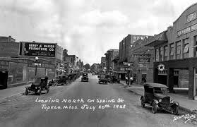 This photo, from a collection in the Lee County Library, shows Spring Street, looking north, as it appeared in 1928. The town was originally named Gum Pond.
