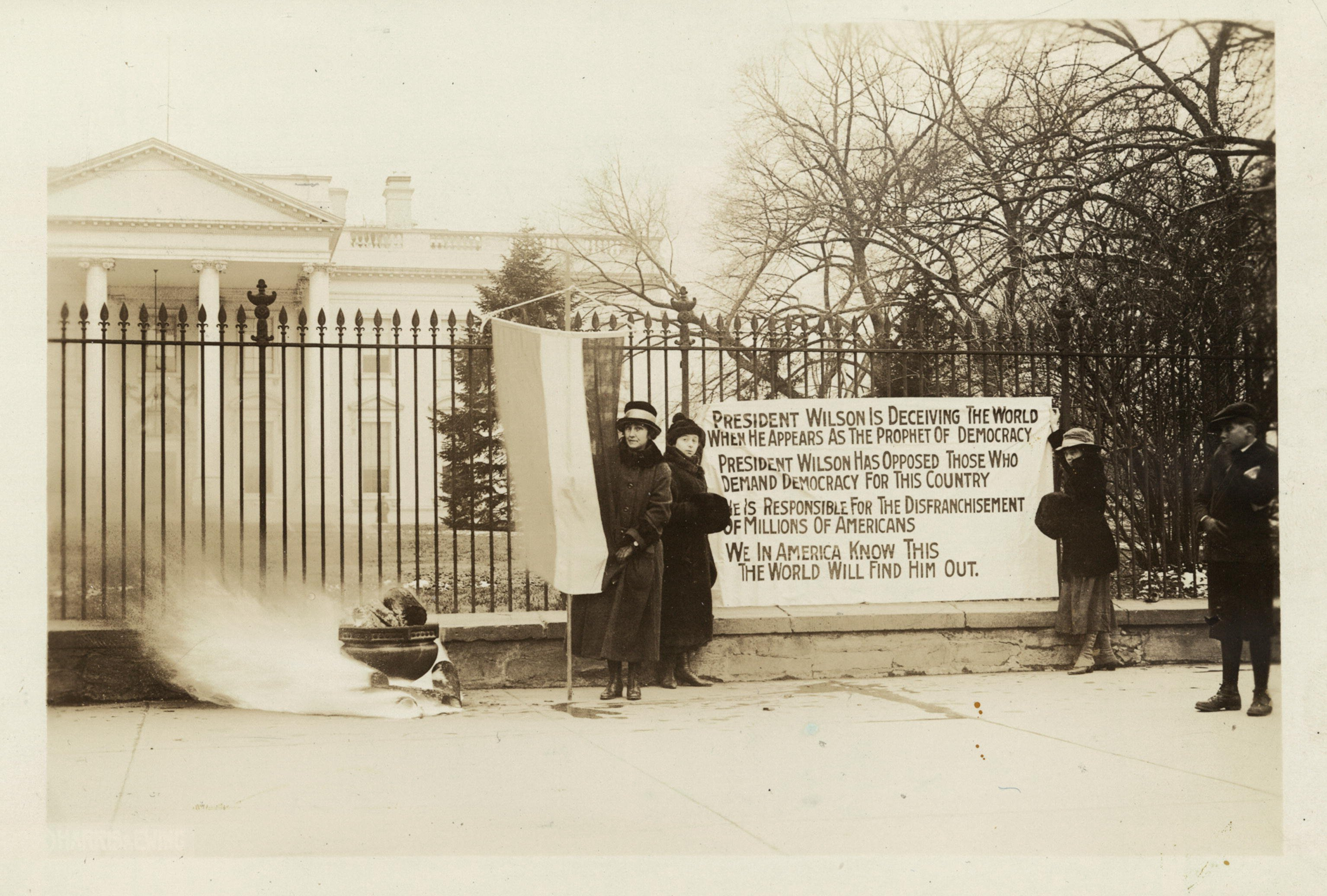 "Picketing continued into 1919 as the Nineteenth Amendment was defeated twice in Congress. Silent Sentinels burned ""watch fires"" in which they burned Wilson's letters and occasionally an effigy in protest. Library of Congress."