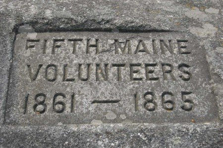 A large granite boulder set on the front lawn of the 5th Maine Regiment Memorial Hall is engraved with the 5th Maine Infantry's pertinent dates (Image courtesy of the Bangor Daily News)
