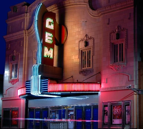 Photo of the beautiful GEM theater illuminated brightly by neon lights