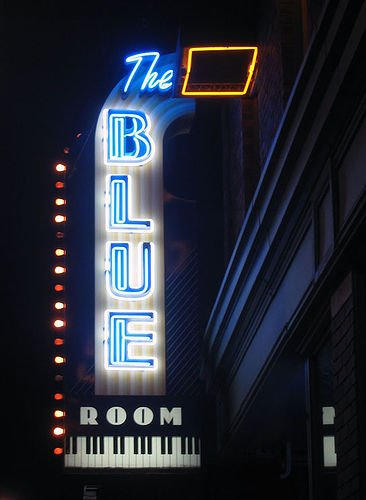 The electric Blue Room sign illuminated in fabulous blue!