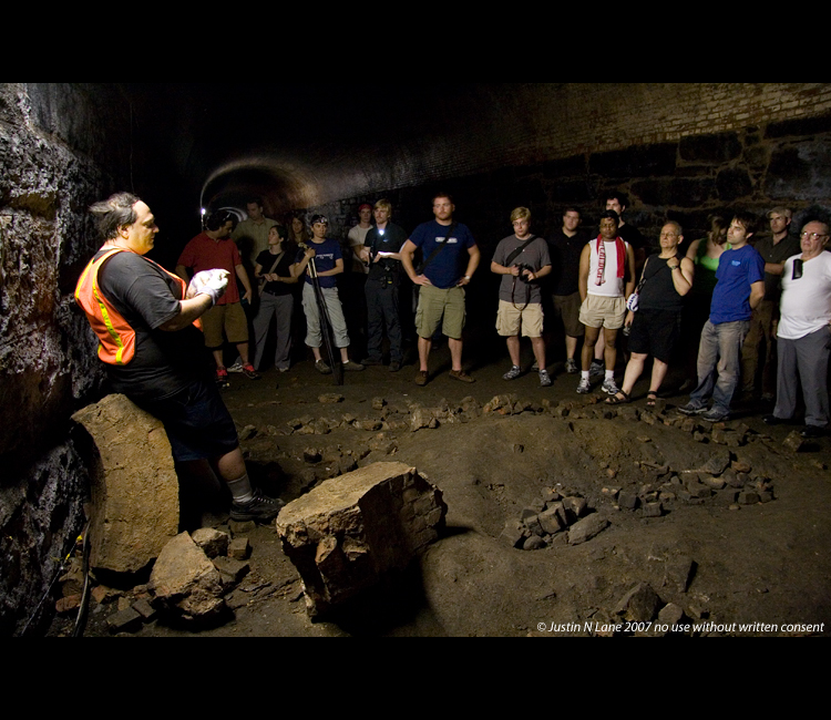 A group tours the tunnel