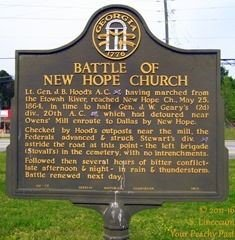 The Battle of New Hope Church Landmark is located in front of New Hope Church in Dallas, Georgia.