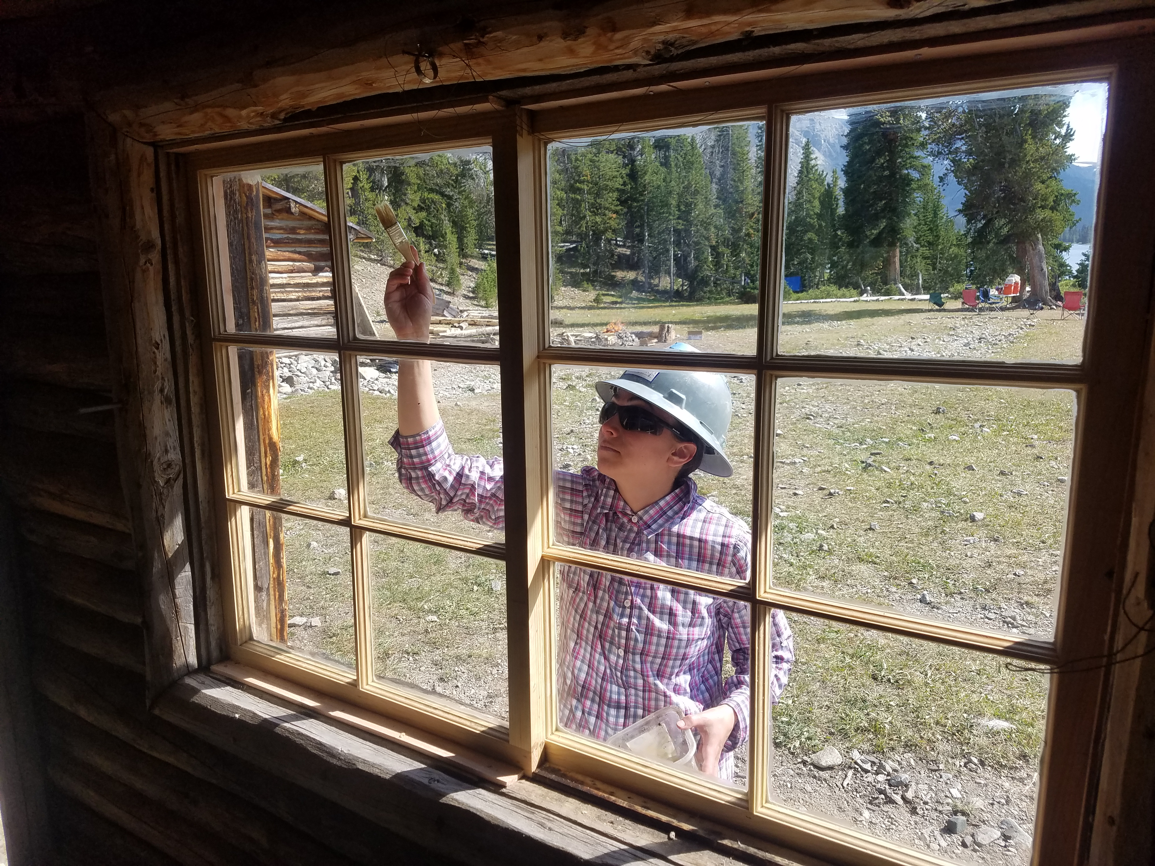 HistoriCorps crew and volunteers worked on repairing and replacing windows at Simpson Lake Lodge in summer 2017.