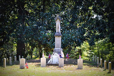The monument to an unknown Confederate soldier located within Friendship Cemetery
