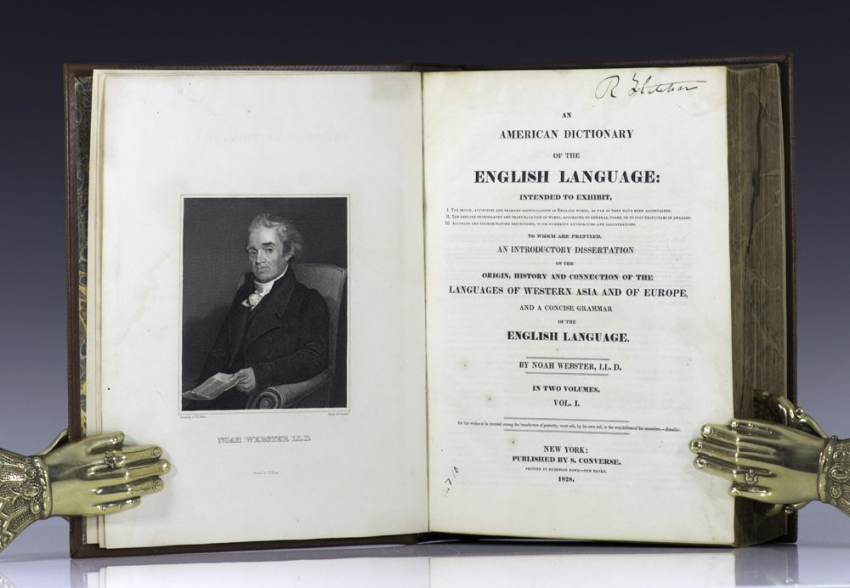 A first edition of Webster's dictionary.