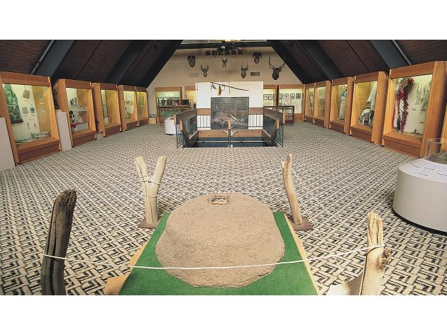 Here is seen one of the large rooms inside the Three Affiliated Tribes Museum, where many of the displays and artifacts are visible.