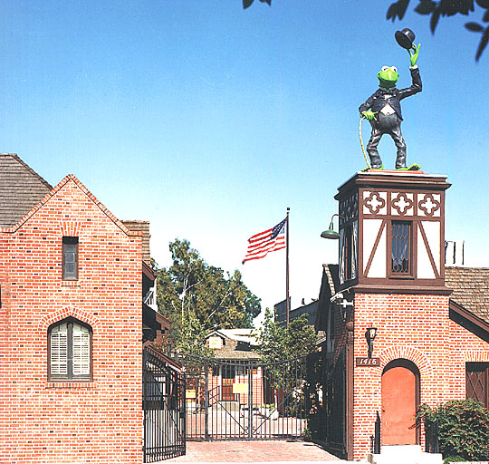 "This is a modern-day glimpse of the Jim Henson Company. In the upper right corner, you can see the statue of Kermit the Frog wearing Chaplain's infamous ""The Little Tramp"" costume. 