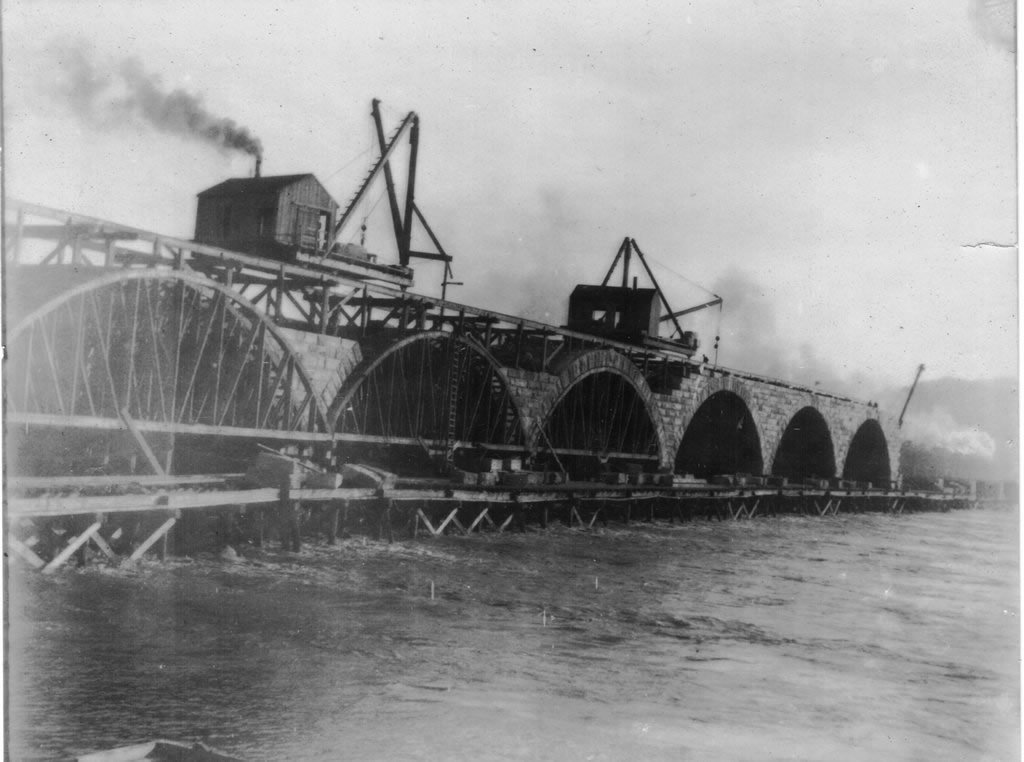 A view of the Rockville Bridge from the river during construction.