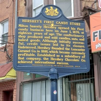 This is the Historical Marker that was erected at the site of the First Candy Store owned and operated by Milton Hershey.