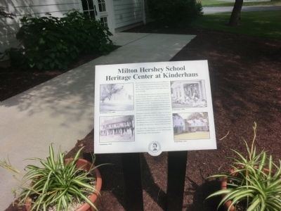 The marker placed at the building to signify the dedication of Milton Hershey.